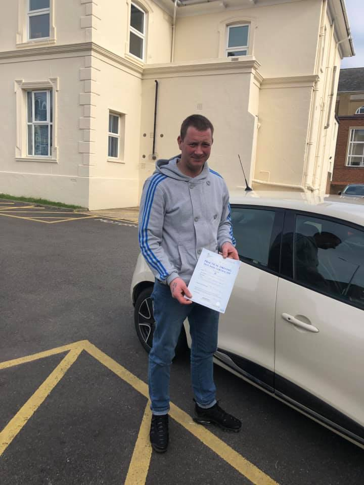 Man holding driving test certificate